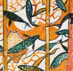fish swimming over a patterned screen